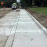 Concrete for new sidewalk being poured next to new cycle track
